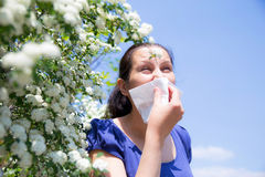 Allergic woman sneezing in handkerchief Royalty Free Stock Photos