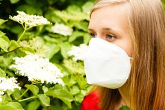 Allergic Woman. Woman allergic to elder pollen, sneezing from it stock photography
