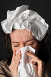 Allergies cold flu. Person with a cold or allergy. Isolated on black Stock Images
