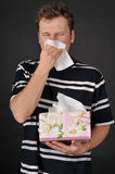 Allergies cold flu. Person with a cold or allergy. Isolated on black Stock Photos