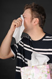 Allergies cold flu. Person with a cold or allergy. Isolated on black Royalty Free Stock Photos