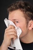 Allergies cold flu. Person with a cold or allergy. Isolated on black Stock Image