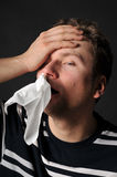 Allergies cold flu. Person with a cold or allergy. Isolated on black Stock Photography