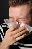 Allergies cold flu. Person with a cold or allergy. Isolated on black Royalty Free Stock Photo