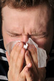 Allergies cold flu. Person with a cold or allergy. Isolated on black Royalty Free Stock Image