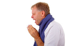 Allergy. Profile of a Man Sneezing into tissue Stock Image