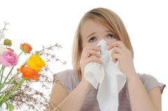 Allergy. Sad woman with tissue and flowers Royalty Free Stock Images