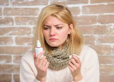 Allergy concept. Home treatment. Effective nasal spray. Runny nose and other symptoms of cold. Nasal drops plastic. Bottle. Nasal spray runny nose remedy. Girl stock photo