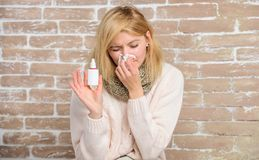 Allergy concept. Home treatment. Nasal drops plastic bottle. Effective nasal spray. Runny nose and other symptoms of. Cold. Nasal spray runny nose remedy. Girl royalty free stock images