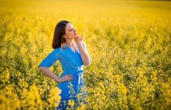 Allergy free concept. Freedom. Attractive girl in blue dress on royalty free stock photos