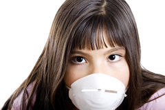 Allergy girl. Studio shot of girl wearing a particle mask - isolated on white Royalty Free Stock Photos