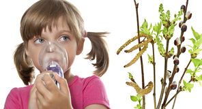 Allergy. Ill little girl using inhaler - respiratory problems Stock Image