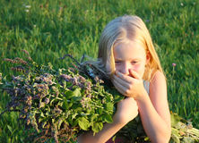 Allergy. Little blonde girl with mint sneezes Royalty Free Stock Photography