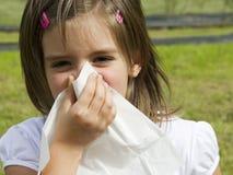Allergy. Little girl with handkerchief outdoor pollen allergy Royalty Free Stock Photo