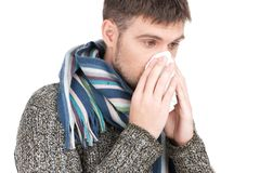 Allergy man blowing his nose in tissue paper. Stock Image