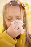 Allergy. Spring portrait of a little girl is blowing her nose Stock Images