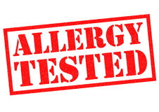 ALLERGY TESTED. Red Rubber Stamp over a white background Stock Photography