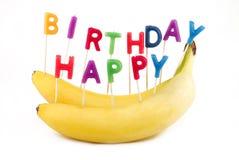 Alles- Gute zum Geburtstagbananen lizenzfreie stockbilder