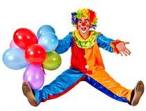 Alles Gute zum Geburtstagclown, der ein Bündel Ballone anhält Stockbild