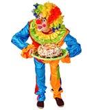 Alles- Gute zum Geburtstagclown, der einen Kuchen hält Lizenzfreie Stockbilder