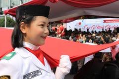 Allevatori indonesiani della bandiera in una cerimonia Immagini Stock Libere da Diritti