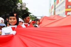 Allevatori indonesiani della bandiera in una cerimonia Fotografie Stock Libere da Diritti