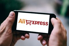 BERLIN, GERMANY - MARCH 23, 2018: Closeup of iPhone Screen with ALIEXPRESS APP LOGO or ICON. Allexpress was launched in the year 2010 and is an online retail royalty free stock photo