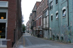 In the alley. A back alley in a southern city Royalty Free Stock Images