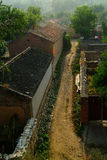Alley. Narrow dirt alley between buildings in an old city in Hebei Province, China Royalty Free Stock Photography