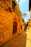 Alley. Narrow Alley with Old Buildings and Israel Flag in Kabbalah City of Safed Royalty Free Stock Photography