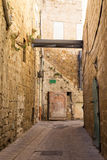 An alley in an ancient old city Acre, Israel. Stock Photo