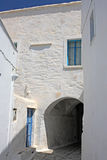 Alley and Arch. An alley in the picturesque village of Pirgos in Tinos island (Greece) passing under an arch Stock Image