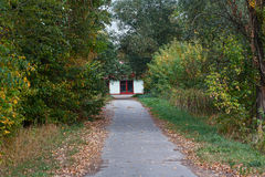 Alley in autumn park and fire station Royalty Free Stock Images