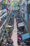An alley in Bangkok, Thailand`s shopping district, where a variety of motorcycles park during working hours. royalty free stock photo