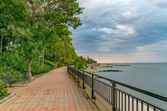 An alley at a beach in Sunny Beach on the Black Sea coast of Bulgaria. Blue bulgarian clouds coastline day horizontal no people nobody outdoor outside resort stock image