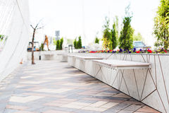 Alley with benches in a modern city Royalty Free Stock Photo
