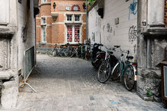 Alley with bicycles parked in historical centre of Leuven Stock Photo
