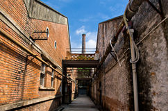 Alley with blue sky. A small alley in an old factory in guangzhou china Stock Photo