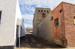 An alley between brick buildings Stock Photo