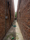 Alley between brick buildings Stock Photos