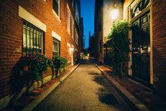 Alley and brick buildings at night, in Beacon Hill, Boston, Mass. Achusetts Royalty Free Stock Image