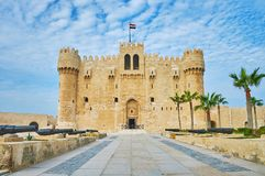 The way to Alexandria castle, Egypt. The alley with cannons leads to the entrance to Qaitbay Fort, one of the notable city landmarks, Alexandria, Egypt stock image