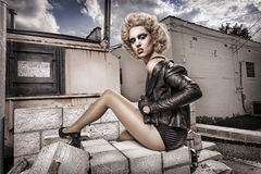 Alley Cats. Young ladies pose with dramatic hairstyles in back alley royalty free stock photo