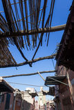 Alley with a ceiling of wooden poles in Marrakesh Royalty Free Stock Photography