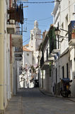 Alley and church of Cadaqués in Spain Royalty Free Stock Photo