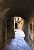 Alley of the city of volterra in italy stock images