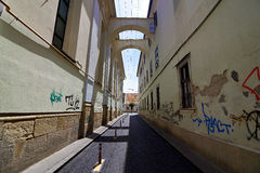 Alley in Cluj, Romania. Symmetrical shot between buildings on an unpopulated street in Cluj, Romania Royalty Free Stock Photos