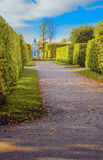 Alley in direction to the pavilion. Grotto in Catherine Park in Tsarskoye Selo, Pushkin, Saint-Petersburg, Russia Royalty Free Stock Photography