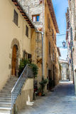 Alley in the downtown of Cortona, in tuscany, Italy Royalty Free Stock Photo