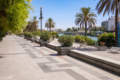Alley on embankment of Guadalquivir River in Seville stock photography
